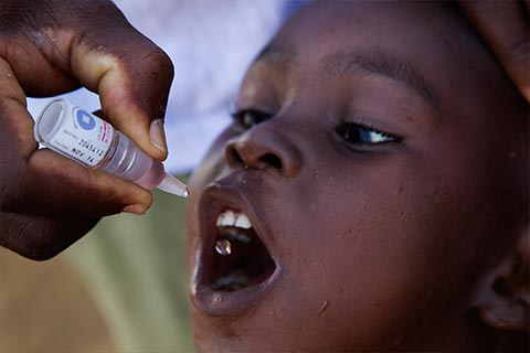 African child receiving Polio vaccine droplet
