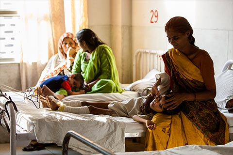 Mothers with their children in clean, brightly lit hospital rooms